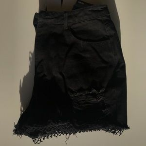 BLACK JEAN SHORTS WITH RIPS AND NETTING ON BOTTOM